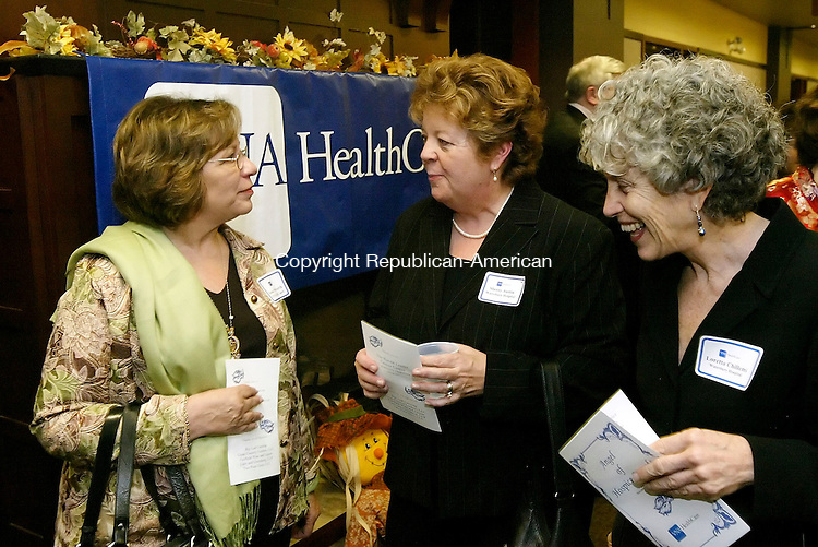 WATERBURY, CT,  15 NOVEMBER 2006, 111506BZ05- Iona Watterworth, past director of Hospice Oncology Palliative Expertise (H.O.P.E.) team, Sherry Austin, R.N. nurse case manager at Waterbury Hospital, and Loretta Chillemi, R.N., director of case management services at Waterbury Hospital, talk during the &quot;Angel of Hospice&quot; awards reception at the Harold Leever Regional Cancer Center in Waterbury Wednesday night.  Austin was being honored with an &quot;Angel of Hospice Award.&quot;<br /> Jamison C. Bazinet Republican-American