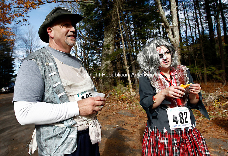 """Torrington, CT- 03 November 2013-110313CM01-  John and Rosanne Field of Torrington, enjoy refreshments following the Sunny Brook Zombie Run 5k at Sunny Brook State Park in Torrington Sunday afternoon. The object of the race was for the """"human"""" runners to get through the course as quickly as possible.  """"Zombies"""" who started after the humans, were to collect as many human lives (flags) as possible while getting to the finish line.  """"Jumper zombies"""" were scattered throughout the course and their object was to grab  flags from runners belts as well.   All proceeds benefit the Northwest CT YMCA charitable services, which provides financial assistance to individuals and families who cannot afford membership & program fees.   Christopher Massa Republican-American"""
