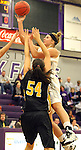 SIOUX FALLS, SD - DECEMBER 6:  Sam Knecht #50 from the University of Sioux Falls shoots over Shantel Lehmann #54 from Wayne State in the first half of their game Friday night at the Stewart Center. (Photo by Dave Eggen/Inertia)