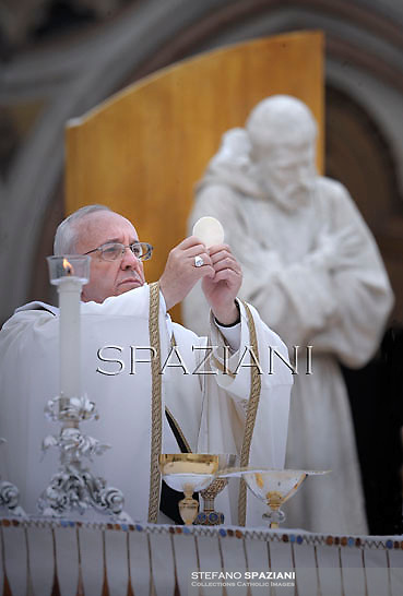 Pope Francis  leads a mass outside the St Francis Basilica as part of his pastoral visit in Assisi on October 4, 2013.