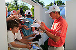 Padraig Harrington signs autographs for eager fans at the end of Round 3 of the BMW PGA Championship at  Wentworth, Surrey, England, 22nd May 2010...Photo Golffile/Eoin Clarke.(Photo credit should read Eoin Clarke www.golffile.ie)....This Picture has been sent you under the condtions enclosed by:.Newsfile Ltd..The Studio,.Millmount Abbey,.Drogheda,.Co Meath..Ireland..Tel: +353(0)41-9871240.Fax: +353(0)41-9871260.GSM: +353(0)86-2500958.email: pictures@newsfile.ie.www.newsfile.ie.