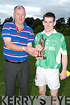Peadar O'Sullivan, Ashes Bar, Glenbeigh, sponsor, pictured presenting the man of the match award to Milltown/Castlemaines Kevin McKenna after the O'Sullivan Cup final in Beaufort in Friday night.