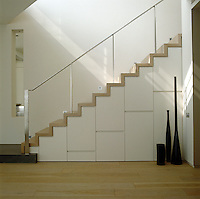 The beauty of wood is left to speak for itself in the design of this simple and elegant staircase
