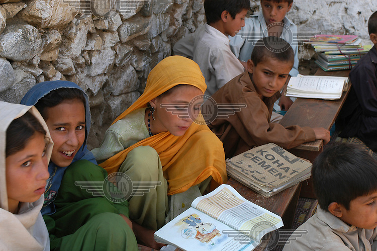 Community school set up by NGO Khwendo Kor in Budalqil village. Khwendo Kor is an NGO working specifically for the empowerment of women and children in Pakistan's deeply conservative North West Frontier Province (NWFP).