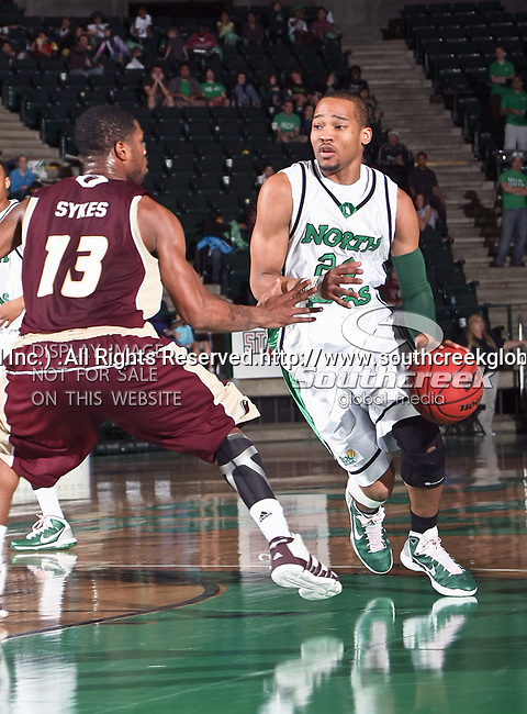 North Texas Mean Green forward Kedrick Hogans (24) in action during the NCAA  basketball game between the University of Louisiana at Monroe Warhawks and the University of North Texas Mean Green at the North Texas Coliseum,the Super Pit, in Denton, Texas. ULM defeated UNT 82 to 75...
