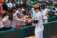 Birmingham Barons shortstop Danny Mendick (2) signs autographs for fans before a game against the Pensacola Blue Wahoos on May 9, 2018 at Regions FIeld in Birmingham, Alabama.  Birmingham defeated Pensacola 16-3.  (Mike Janes/Four Seam Images)