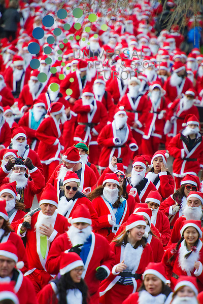 Thousands of Santas converge on Princes Street Gardens for one of the largest Santa Runs in the UK, Edinburgh, Scotland, 11th December, 2011 .Picture:Scott Taylor Universal News And Sport (Europe) .All pictures must be credited to www.universalnewsandsport.com. (Office)0844 884 51 22.