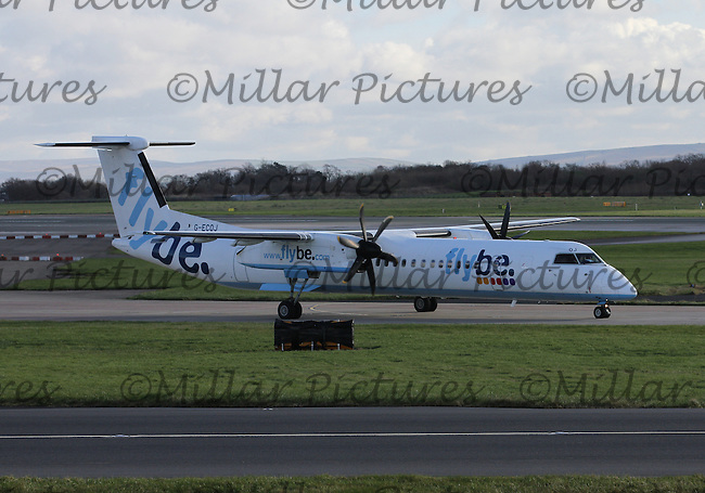 A Flybe Bombardier Dash 8 Q400 Registration G-ECOJ taxying at Manchester Airport on 14.2.16 bound for Isle of Man Airport.