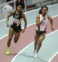 NWA Democrat-Gazette/ANDY SHUPE<br /> Arkansas sophomore Kiara Parker (1024) pulls ahead of Purdue senior Devynne Charlton while competing in the 200 meters Saturday, Feb. 11, 2017, during the Tyson Invitational in the Randal Tyson Track Center in Fayetteville. Visit nwadg.com/photos to see more photographs from the meet.
