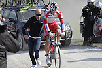 Rudiger Selig (GER) Team Katusha gets a push from his mechanic after a wheel change on the 7th sector of strade the climb of Monte Sante Maria during the 2014 Strade Bianche race over the white dusty gravel roads of Tuscany running 200km from San Gimignano to Siena, Italy. 8th March 2014.<br /> Picture: Eoin Clarke www.newsfile.ie