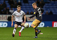 Bolton Wanderers' Joe Williams competing with Sheffield Wednesday's Barry Bannan <br /> <br /> Photographer Andrew Kearns/CameraSport<br /> <br /> The EFL Sky Bet Championship - Bolton Wanderers v Sheffield Wednesday - Tuesday 12th March 2019 - University of Bolton Stadium - Bolton<br /> <br /> World Copyright © 2019 CameraSport. All rights reserved. 43 Linden Ave. Countesthorpe. Leicester. England. LE8 5PG - Tel: +44 (0) 116 277 4147 - admin@camerasport.com - www.camerasport.com