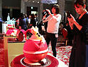 October 12, 2017, Tokyo, Japan - Journalists take pictures of the Prince Hotels chain's Christmas cake collection at the Prince Park Tower hotel  in Tokyo on Thursday, Octoebr 12, 2017. The hotel chain started to accept orders and will deliver before Christmas Day.   (Photo by Yoshio Tsunoda/AFLO) LWX -ytd-
