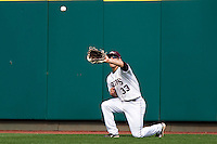 Spiker Helms (33) of the Missouri State Bears catches a fly ball during a game against the Wichita State Shockers on April 9, 2011 at Hammons Field in Springfield, Missouri.  Photo By David Welker/Four Seam Images