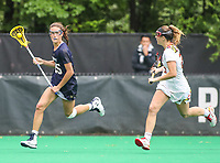 College Park, MD - May 19, 2018: Navy Kayla Harris (25) looks to pass the ball during the quarterfinal game between Navy and Maryland at  Field Hockey and Lacrosse Complex in College Park, MD.  (Photo by Elliott Brown/Media Images International)