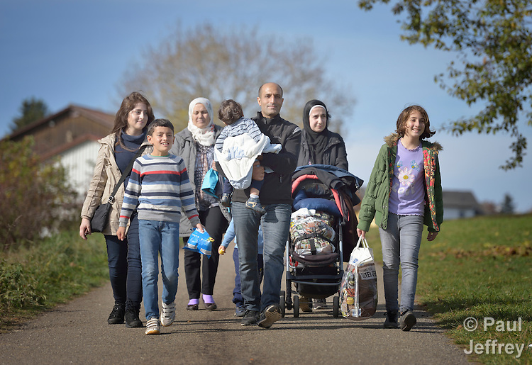 Syrian refugees walk in the countryside outside Messstetten, Germany. They have applied for asylum in Germany and are awaiting word on the government's decision. Meanwhile, they live in a room in a former army barracks in Messstetten.