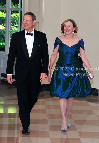 Chief Justice of the United States John G. Roberts, Jr. and his wife, Jane, arrive for a State Dinner in honor of Chancellor Angela Merkel of Germany at the White House in Washington, D.C.  on Tuesday, June 7, 2011..Credit: Ron Sachs / CNP