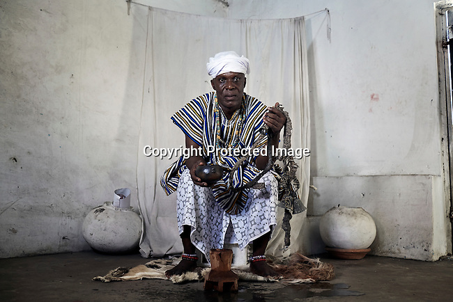 "ACCRA, GHANA APRIL 17: A Nana priest shows where he consults clients for Ghana ""Sakava"" scammers, where they come to find power to ask for big scams on April 17, 2015 in Accra, Ghana.  The country is a center for different online scams. Both men and women are lured to send cash to someone they only met on the net.  Due to limited opportunities, many youngsters spend their days in Internet cafes trying to scam people form all over the world. (Photo by: Per-Anders Pettersson)"