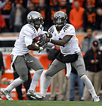 12/04/10-- Oregon quarterback Darron Thomas hands the ball off to running back LaMichael James in the second half of the Civil War game at Reser Stadium in Corvallis, Or..Photo by Jaime Valdez