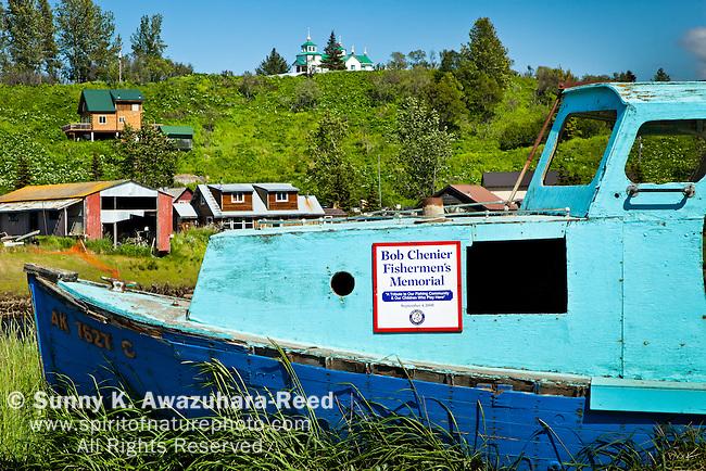 Bob Chenier Fishermen's Memorial - old fishing boat at Old Ninilchik Village on a sunny day. Russian Orthodox Church in  background. Ninilchik, Kenai Peninsula, Southcentral Alaska, Summer.