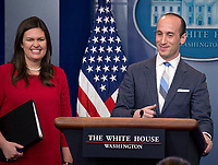 White House senior advisor for policy Stephen Miller conducts a press briefing on the Trump Administration's support of the Reforming American Immigration for a Strong Economy (RAISE) Act in the Brady Press Briefing Room of the White House in Washington, DC on Wednesday, August 2, 2017. To his right is White House press secretary Sarah Huckabee Sanders. Photo Credit: Ron Sachs/CNP/AdMedia