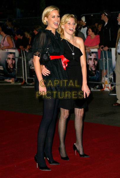"ALICE EVANS & ELIZABETH BANKS.Arrivals - ""Children Of Men"" Premiere, .Odeon Leicester Square Cinema, .London, England, September 19th 2006..full length black dress red ribbon belt puffy skirt sleeves tights mini.Ref: AH.www.capitalpictures.com.sales@capitalpictures.com.©Adam Houghton/Capital Pictures."