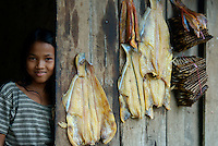 Siam Reap, Cambodia, Little Girl and dried fish
