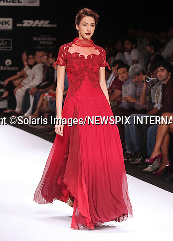"Mumbai, India-06/03/2012: LAKME FASHION WEEK.Creation from designer Kartikeya and Isha at the LFW Summer/Resort 2012 fashion collection, during Lakme Fashion Week 2012 in Mumbai, India..Mandatory Photo Credit: ©Ramesh Nair-Solaris Images/NEWSPIX INTERNATIONAL..**ALL FEES PAYABLE TO: ""NEWSPIX INTERNATIONAL""**..PHOTO CREDIT MANDATORY!!: NEWSPIX INTERNATIONAL(Failure to credit will incur a surcharge of 100% of reproduction fees)..IMMEDIATE CONFIRMATION OF USAGE REQUIRED:.Newspix International, 31 Chinnery Hill, Bishop's Stortford, ENGLAND CM23 3PS.Tel:+441279 324672  ; Fax: +441279656877.Mobile:  0777568 1153.e-mail: info@newspixinternational.co.uk"