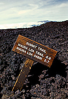 A fallen sign for Mauna Loa cabin and trail appears on the barren landscape of the mountain.