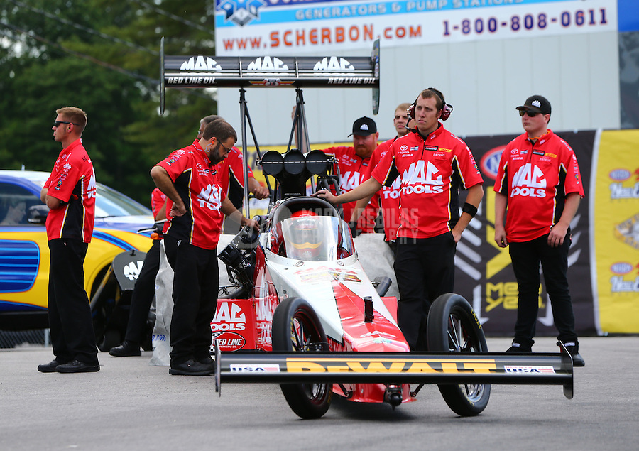 Jun 6, 2016; Epping , NH, USA; NHRA top fuel driver Doug Kalitta with crew members during the New England Nationals at New England Dragway. Mandatory Credit: Mark J. Rebilas-USA TODAY Sports