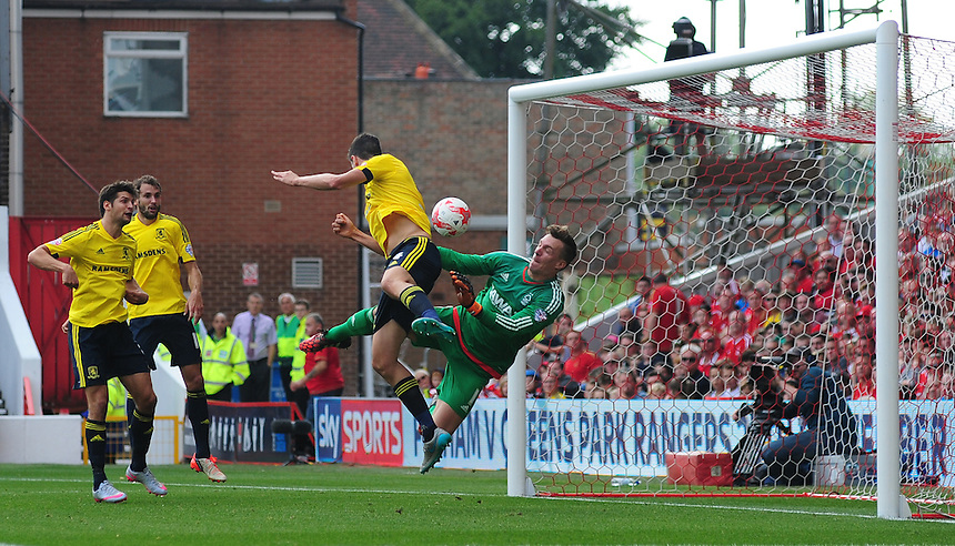 Middlesbrough's Daniel Ayala scores his sides second goal as he beats Nottingham Forest's Dorus de Vries to the high ball<br /> <br /> Photographer Chris Vaughan/CameraSport<br /> <br /> Football - The Football League Sky Bet Championship - Nottingham Forest v Middlesbrough - Saturday 19th September 2015 - City Ground - Nottingham<br /> <br /> &copy; CameraSport - 43 Linden Ave. Countesthorpe. Leicester. England. LE8 5PG - Tel: +44 (0) 116 277 4147 - admin@camerasport.com - www.camerasport.com