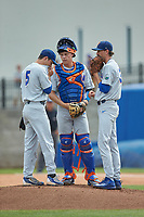 (L-R) Dalton Guthrie (5), JJ Schwarz (22), and Jackson Kowar (37) meet on the mound during the game against the Wake Forest Demon Deacons in Game Two of the Gainesville Super Regional of the 2017 College World Series at Alfred McKethan Stadium at Perry Field on June 11, 2017 in Gainesville, Florida.  (Brian Westerholt/Four Seam Images)