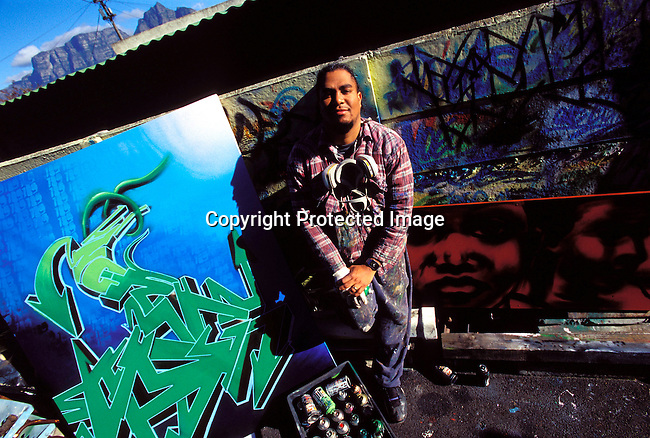 dienvgr00031 Graffiti artist SKY 189 , Evaron Orange in front one of his art works on September 5, 2002 in downtown Cape Town, South Africa. .©Per-Anders Pettersson/iAfrika Photos