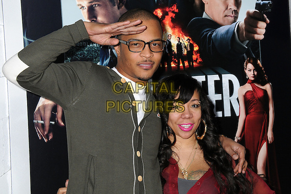 "T.I. (T.I.P.) (Clifford Joseph Harris, Jr.) & Tiny (Tameka Cottle).""Gangster Squad"" Los Angeles Premiere held at Grauman's Chinese Theatre, Hollywood, California, USA..January 7th, 2013.half length grey gray cardigan glasses red top hand on hip married husband wife arm over shoulder salute .CAP/ADM/BP.©Byron Purvis/AdMedia/Capital Pictures."