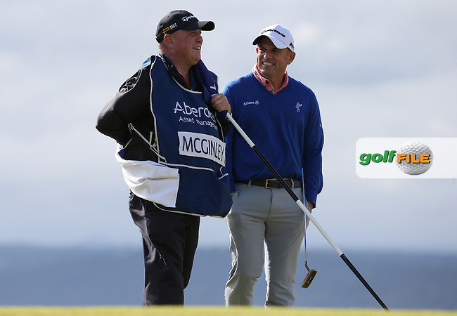 Paul McGinley (IRL) has a chuckle with caddie &quot;Edinburgh&quot; Jimmy Rae on the 3rd green during Round One of the 2016 Aberdeen Asset Management Scottish Open, played at Castle Stuart Golf Club, Inverness, Scotland. 07/07/2016. Picture: David Lloyd | Golffile.<br /> <br /> All photos usage must carry mandatory copyright credit (&copy; Golffile | David Lloyd)