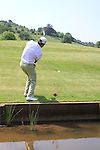 Graeme McDowell chips his ball after a misadventure in the water on the 5th, Two practice drops ended in his balls going in the water on day two of the Celtic Manor wales Open 2010.Picture Fran Caffrey/Newsfile.ie
