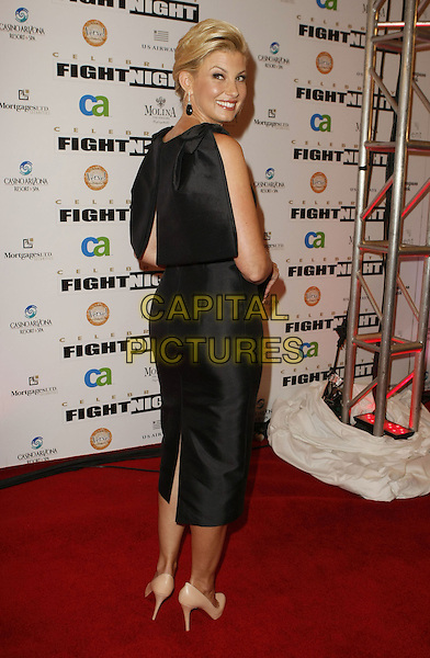 FAITH HILL .Muhammad Ali's Celebrity Fight Night XIV held at JW Marriott Desert Ridge Resort & Spa, Phoenix, Arizona, USA, 05 April 2008..full length black dress back over shoulder earrings rear behind cream beige shoes .CAP/ADM/MJT.©MJT/Admedia/Capital Pictures
