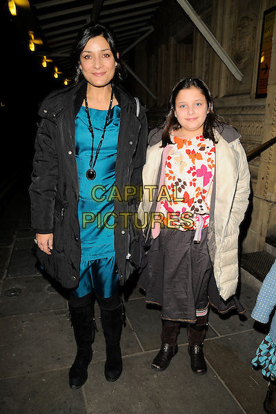 AMITA DHIRI & GUEST.The Christmas Carols with the Stars festive concert, Royal Albert Hall, London, England..December 8th, 2008.full length blue silk satin dress grey gray coat jacket necklace skirt white pink boots .CAP/CAN.©Can Nguyen/Capital Pictures.