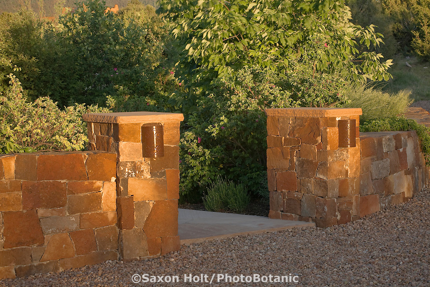 Stone pillar, masonry entry gate into New Mexico xeriscape, drought tolerant garden