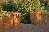 Stone pillar, masonry entry gate into New Mexico xeriscape, drought tolerant garden