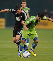 Seattle Sounders forward Freddy Montero (17) tries to keep possession of the ball against DC United midfielder Chris Pontius (13).  Seattle Sounders defeated DC United 1-0 at RFK Stadium, Thursday July 15, 2010.