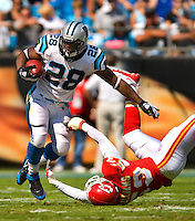 Carolina Panthers' Jonathan Stewart (28) runs the ball against Kansas City Chiefs linebacker Demorrio Williams (53) during a NFL football game at Bank of America Stadium in Charlotte, NC.