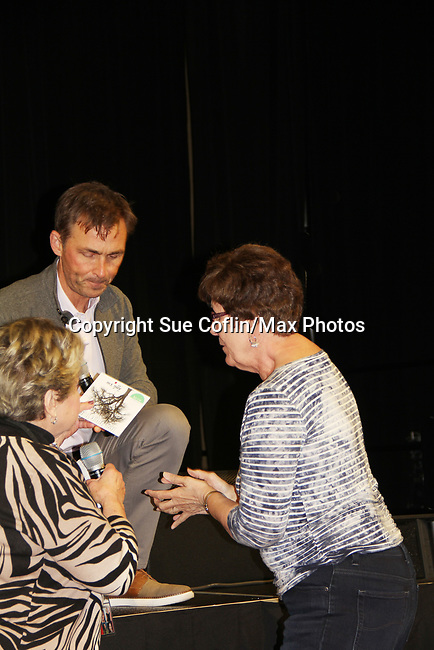 General Hospital's actor James Patrick Stuart signs his new CD Apple Tree for a fan on October 5, 2019 at the Hollywood Casino, Columbus, Ohio with a Q & A and a VIP meet and greet. (Photo by Sue Coflin/Max Photo)