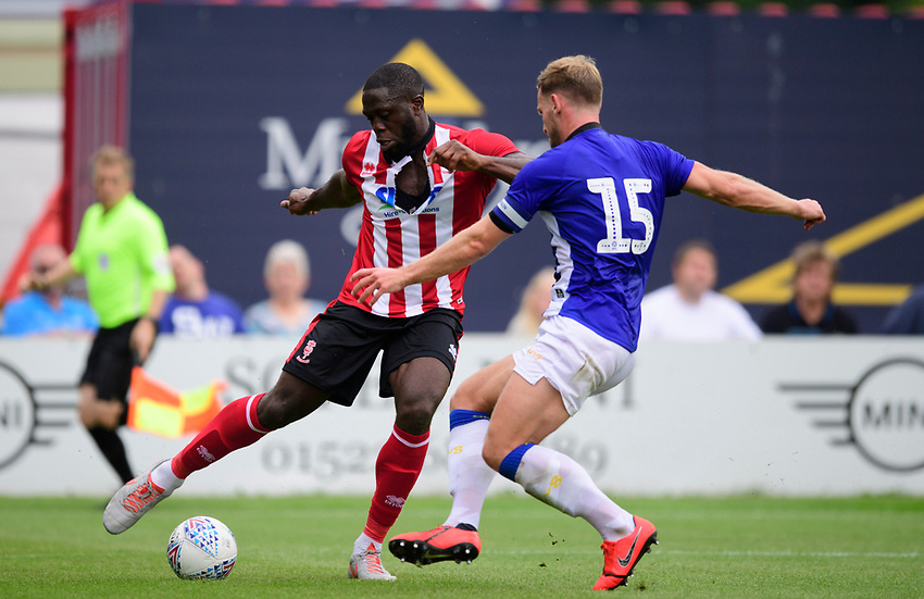 Lincoln City's John Akinde vies for possession with Sheffield Wednesday's Tom Lees<br /> <br /> Photographer Chris Vaughan/CameraSport<br /> <br /> Football Pre-Season Friendly - Lincoln City v Sheffield Wednesday - Saturday July 13th 2019 - Sincil Bank - Lincoln<br /> <br /> World Copyright © 2019 CameraSport. All rights reserved. 43 Linden Ave. Countesthorpe. Leicester. England. LE8 5PG - Tel: +44 (0) 116 277 4147 - admin@camerasport.com - www.camerasport.com
