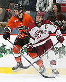 Tom Kroshus (Princeton - 4), Kyle Criscuolo (Harvard - 11) - The Harvard University Crimson defeated the visiting Princeton University Tigers 5-0 on Harvard's senior night on Saturday, February 28, 2015, at Bright-Landry Hockey Center in Boston, Massachusetts.