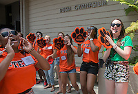 The O-Team cheers for incoming students and their parents as they enter Rush Gym during Orientation, Aug. 21, 2015.<br /> (Photo by Marc Campos, Occidental College Photographer)
