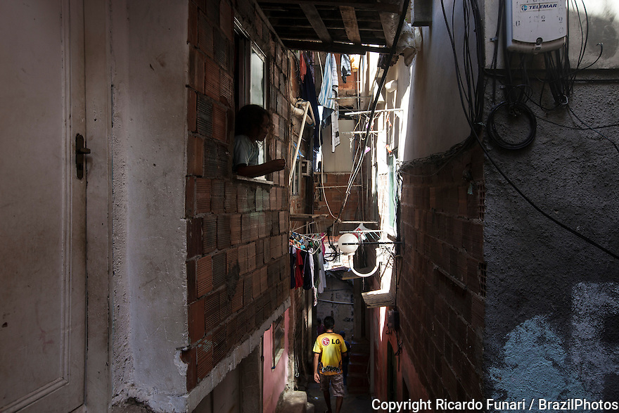 Child at window in a narrow way at Favela Santa Marta, Rio de Janeiro, Brazil - improper dwelling conditions, because of crowding, unsanitary conditions, poor nutrition and pollution, disease is rampant in the poorer favelas and infant mortality rates are high.