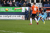 Michael Harriman of Wycombe Wanderers (right) shoots during the Sky Bet League 2 match between Luton Town and Wycombe Wanderers at Kenilworth Road, Luton, England on 26 December 2015. Photo by David Horn.