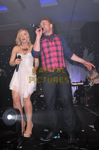 Daniel and Natasha Bedingfield.'Global Angels Awards', The Park Plaza Hotel, Westminster, London, England. 2nd December 2011..music on stage live concert gig performing full  length microphone   duet brother sister siblings strapless white dress pink blue tartan plaid shirt waistcoat tie .CAP/MAR.© Martin Harris/Capital Pictures.