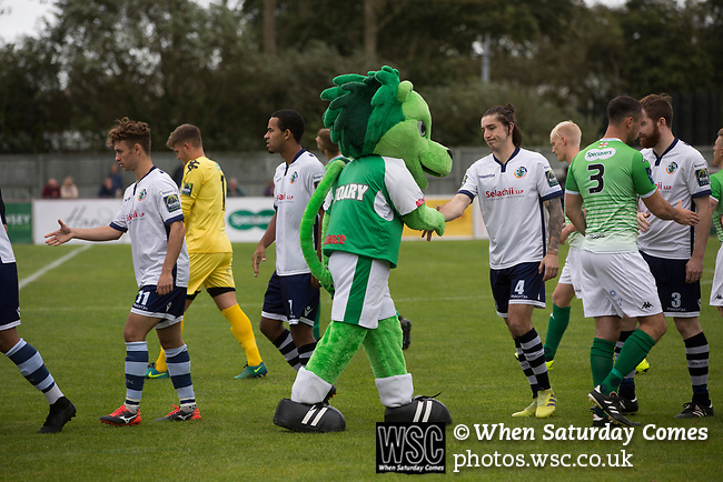 Guernsey 0 Corinthian-Casuals 1, 10/09/2017. Footes Lane, Isthmian League Division One. Home mascot Roary the Lion shaking hands with opponents before kick-off as Guernsey (in green) take on Corinthian-Casuals in a Isthmian League Division One South match at Footes Lane. Formed in 2011, Guernsey FC are a community club located in St. Peter Port on the island of Guernsey and were promoted to the Isthmian League Division One South in 2013. The visitors from Kingston upon Thames won the fixture by 1-0, watched by a crowd of 614 spectators. Photo by Colin McPherson.