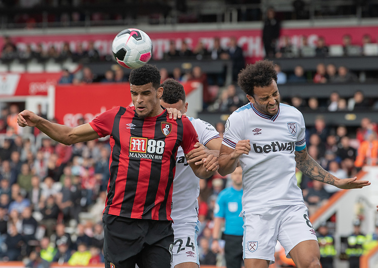 Bournemouth's Dominic Solanke (left) battles with West Ham United's Ryan Fredericks (centre) and Felipe Anderson (right) <br /> <br /> Photographer David Horton/CameraSport<br /> <br /> The Premier League - Bournemouth v West Ham United - Saturday 28th September 2019 - Vitality Stadium - Bournemouth<br /> <br /> World Copyright © 2019 CameraSport. All rights reserved. 43 Linden Ave. Countesthorpe. Leicester. England. LE8 5PG - Tel: +44 (0) 116 277 4147 - admin@camerasport.com - www.camerasport.com